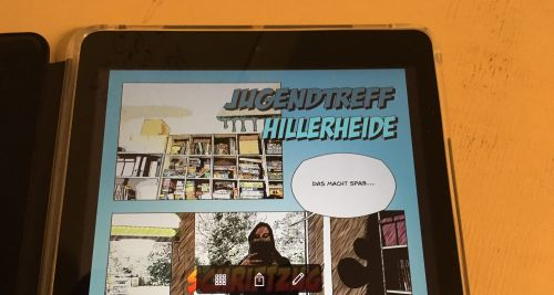 "iPad mit Comic-App, Titel des Comics ""Jugendtreff Hillerheide"", Sprechblasentext: ""Das macht Spaß"""