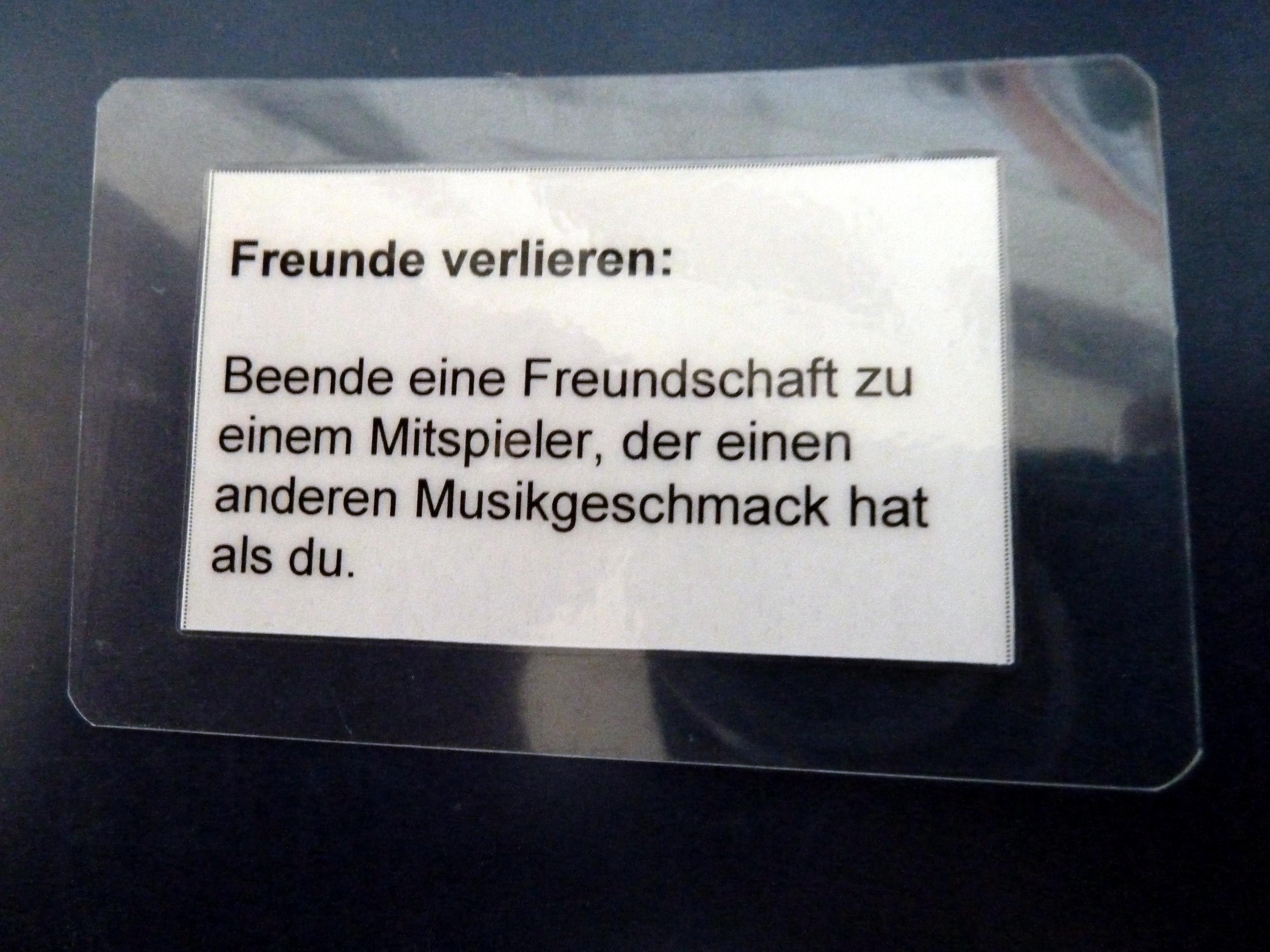 Aktionskarte mit dem Text: Freunde verlieren: Beende eine Freundschaft zu einem anderen Mitspieler, der einen anderen Musikgeschmack hat.
